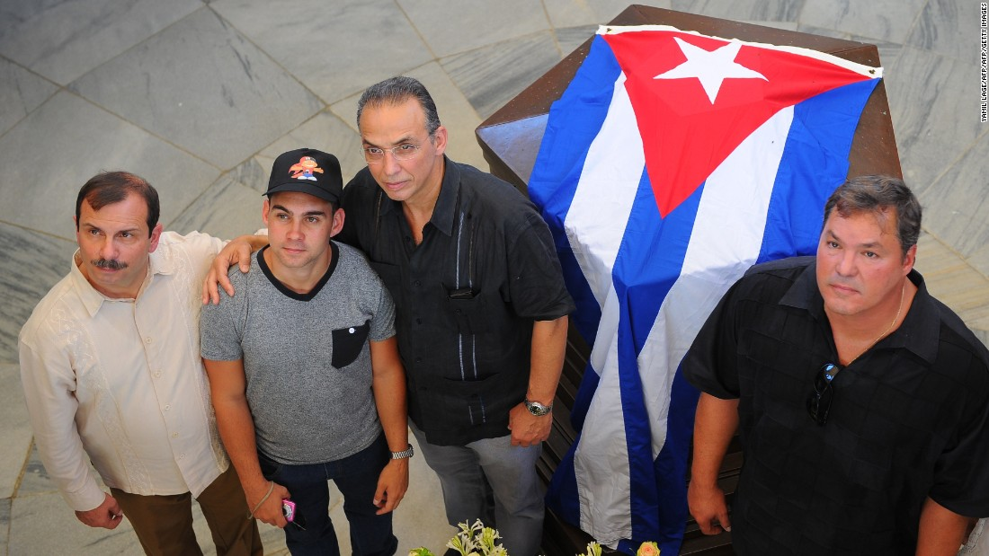"Elian Gonzalez, second left, poses with members of the so-called ""<a href=""http://www.cnn.com/2014/12/17/world/americas/cuba-who-are-released/"">Cuban Five</a>"" intelligence agents, from left, Fernando Gonzalez, Antonio Guerrero and  Ramon Labanino, at the mausoleum of national hero Jose Marti in Santiago de Cuba on July 24. Speaking to ABC News in May, Gonzalez said he would like to visit the U.S. again one day to thank the people who supported his return to Cuba."