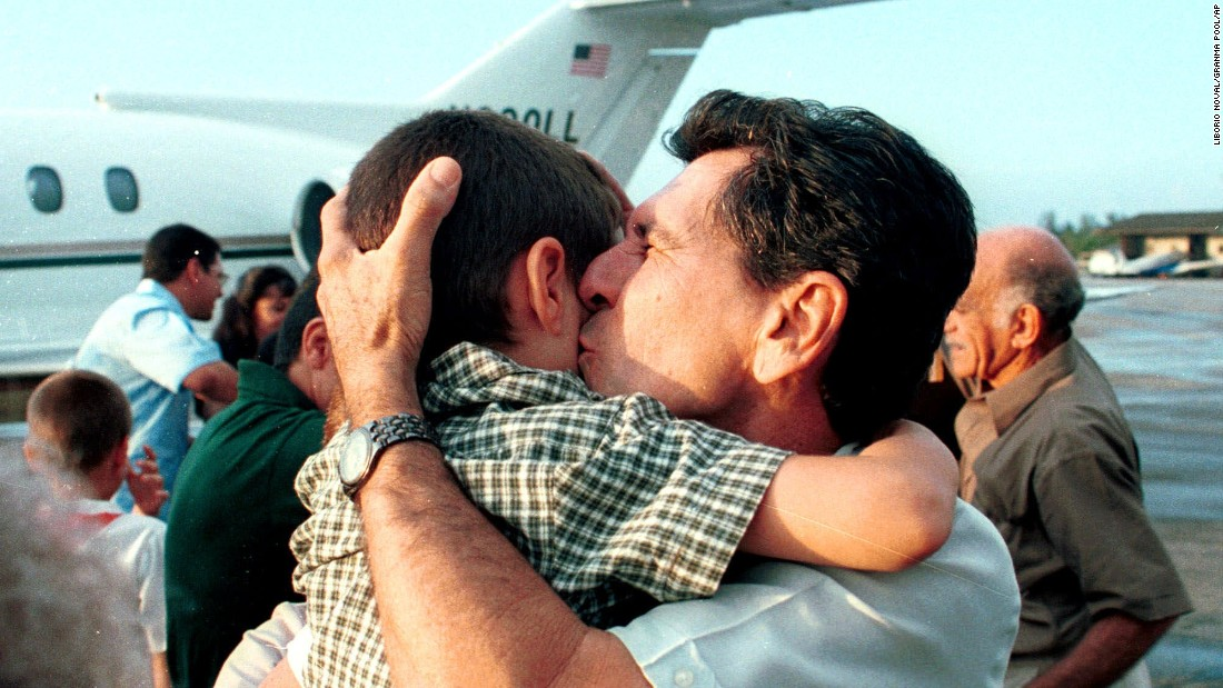 Following more court proceedings, ending with the Supreme Court rejecting the Miami relatives' efforts to get him back, the family flew home to Cuba. His grandfather Juan Gonzalez hugs him upon his arrival at the Jose Marti Airport in Havana in June 2000, seven months after he was found in the water.