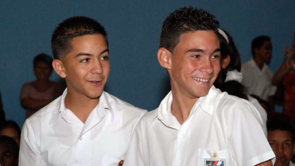 Elian, right, accompanied by a fellow military student, smiles in June 2008 in Havana as he attends an event marking the 80th anniversary of the birth of a Cuban national hero, Argentina