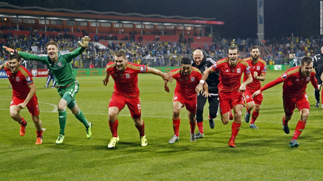 Welsh soccer players celebrate Saturday, October 10, after learning that they had qualified for the European Championship next summer. Euro 2016 will be Wales' first major tournament since the 1958 World Cup.