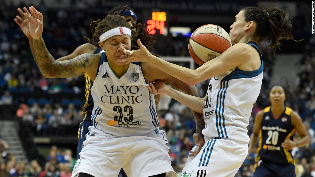 Minnesota teammates Seimone Augustus, left, and Anna Cruz go after a loose ball during Game 2 of the WNBA Finals on Tuesday, October 6. Minnesota and Indiana split the first four games of the series, and the decisive Game 5 will take place on Wednesday, October 14.