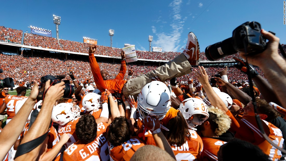 Texas football players carry head coach Charlie Strong after the Longhorns upset their rival Oklahoma on Saturday, October 10. Texas won 24-17 to hand Oklahoma its first loss of the season.