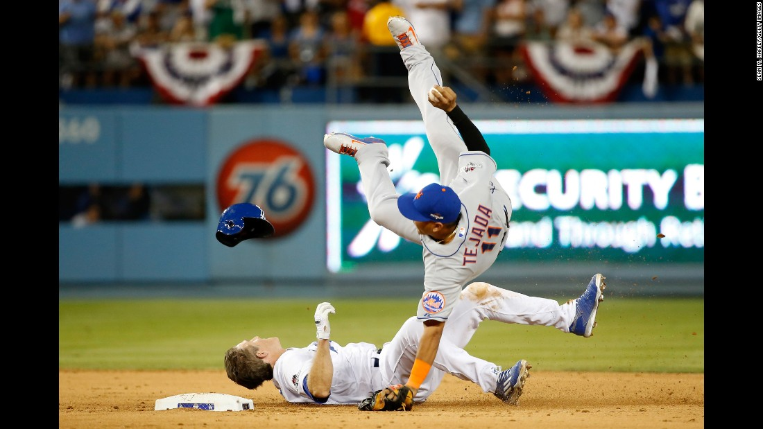 "A slide by Los Angeles' Chase Utley takes out New York Mets shortstop Ruben Tejada during Game 2 of the National League Division Series on Saturday, October 10. Tejada's leg was broken on the slide. Major League Baseball deemed it illegal and suspended Utley for two games. Utley appealed the suspension, and a <a href=""http://www.latimes.com/sports/dodgers/dodgersnow/la-sp-dn-agent-suspension-outrageous-20151011-story.html"" target=""_blank"">statement from his agent</a> said ""Chase did what all players are taught to do in this situation -- break up the double play. We routinely see plays at second base similar to this one that have not resulted in suspensions."""