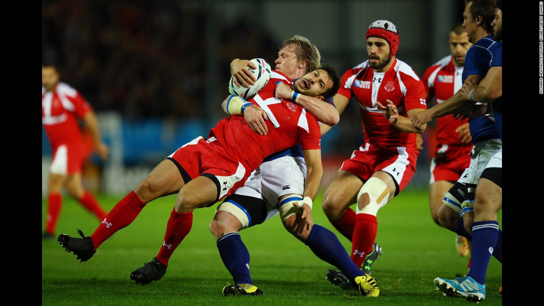 Georgia's Lasha Malaghuradze is pulled down by Namibia's Renaldo Bothma during a Rugby World Cup match in Exeter, England, on Wednesday, October 7.