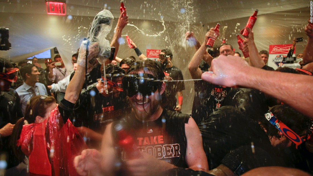 The Houston Astros celebrate in their locker room after they defeated the New York Yankees in the American League wild card game on Tuesday, October 6.