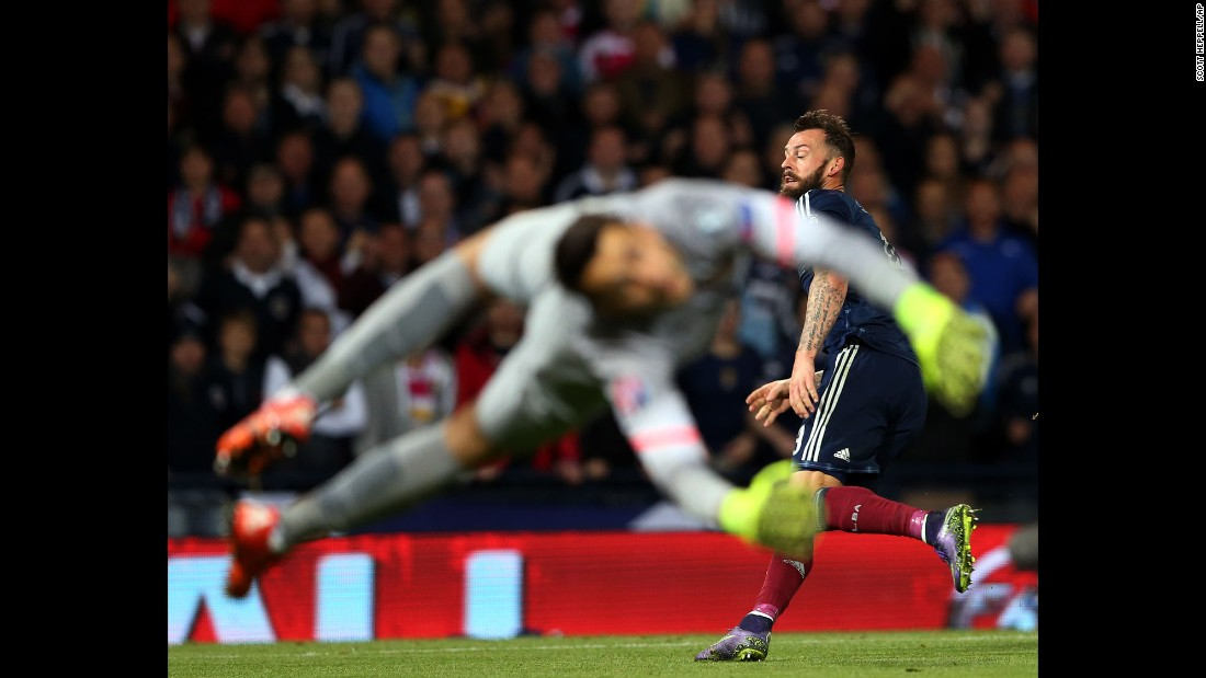Polish goalkeeper Lukasz Fabianski can't stop a shot from Scotland's Steven Fletcher during a Euro 2016 qualifier in Glasgow, Scotland, on Thursday, October 8. The match ended in a 2-2 draw.