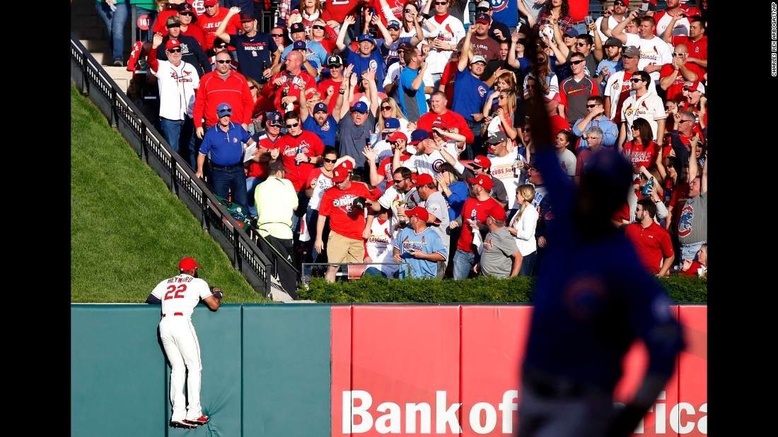 St. Louis outfielder Jason Heyward can only watch as Jorge Soler's home run lands in the stands during Game 2 of the National League Division Series on Saturday, October 2. Soler and the Chicago Cubs won 6-3 to even the series at one game apiece. The silhouette at right is Chicago's Dexter Fowler, who scored on the play.