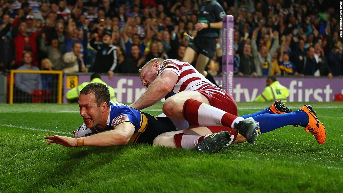 Danny McGuire of the Leeds Rhinos scores a try against the Wigan Warriors during the Super League Grand Final on Saturday, October 10. Leeds won the match 22-20 in Manchester, England.