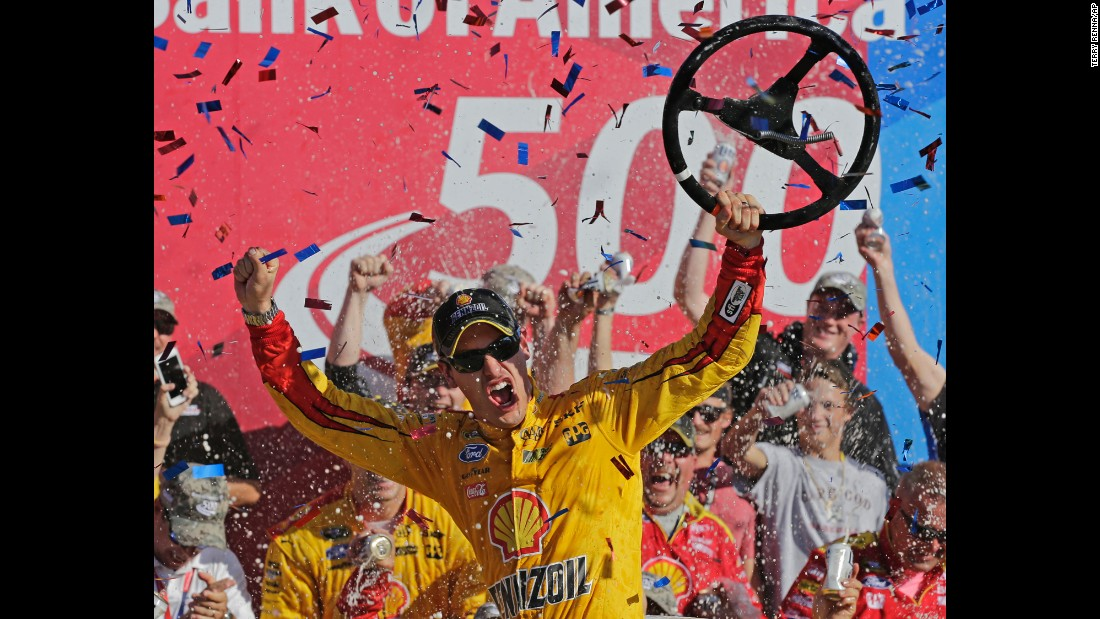 NASCAR driver Joey Logano celebrates in Victory Lane after winning the Sprint Cup race at Charlotte Motor Speedway on Sunday, October 11. Logano earned a spot in the third round of NASCAR's Chase for the Sprint Cup.