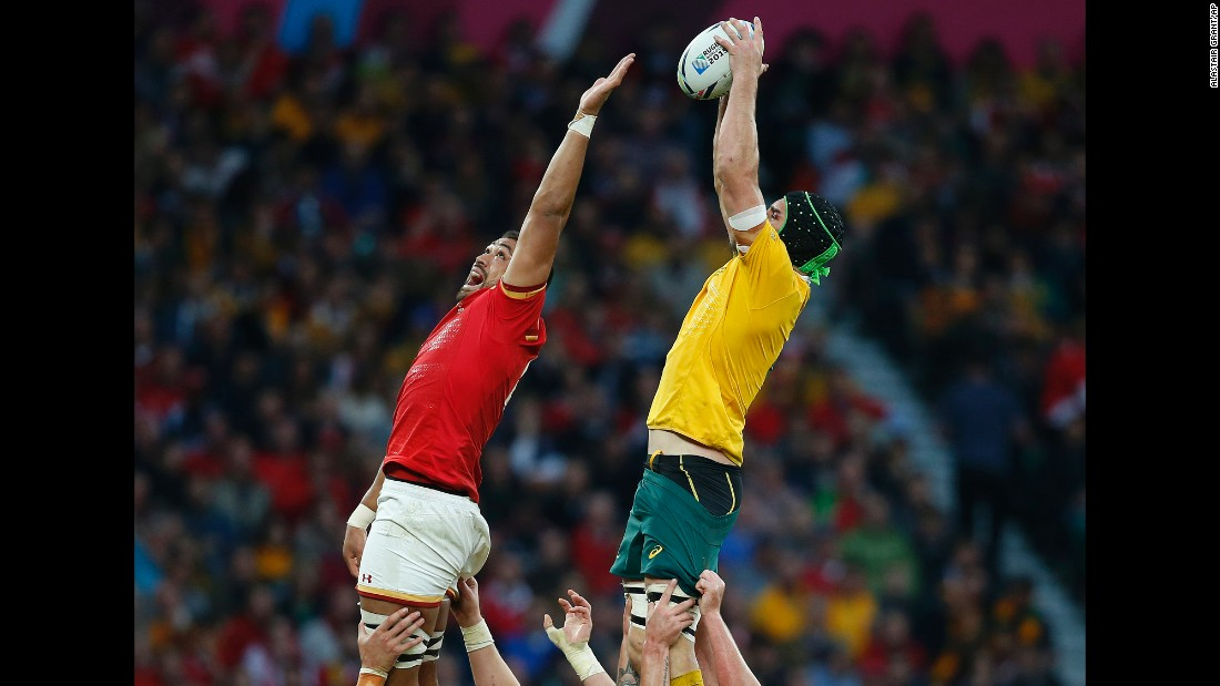 Australia's Scott Fardy, right, wins a line out over Wales' Taulupe Faletau during a Rugby World Cup match in London on Saturday, October 10. Australia won 15-6, but both teams advanced to the quarterfinals.