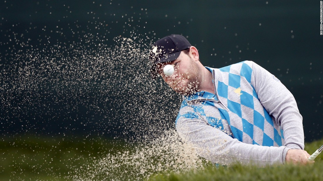 Branden Grace hits a bunker shot during the Presidents Cup on Saturday, October 10.