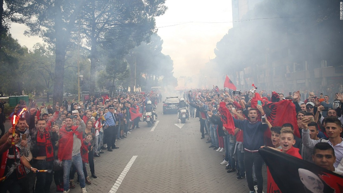 Albania's footballers touched down in Tirana Monday less than 24 hours after qualifying for the 2016 European Championship finals. Thousands lined the streets to greet them.