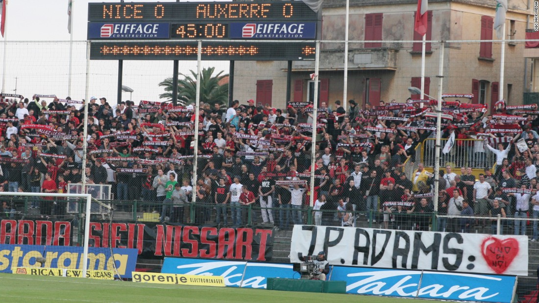 "Nice fans display a banner reading ""J-P Adams: One of Us"" on 28 April 2007, ahead of their former player's sons -- Laurent and Frédéric -- symbolically kicking off a match against Auxerre in tribute to their father."
