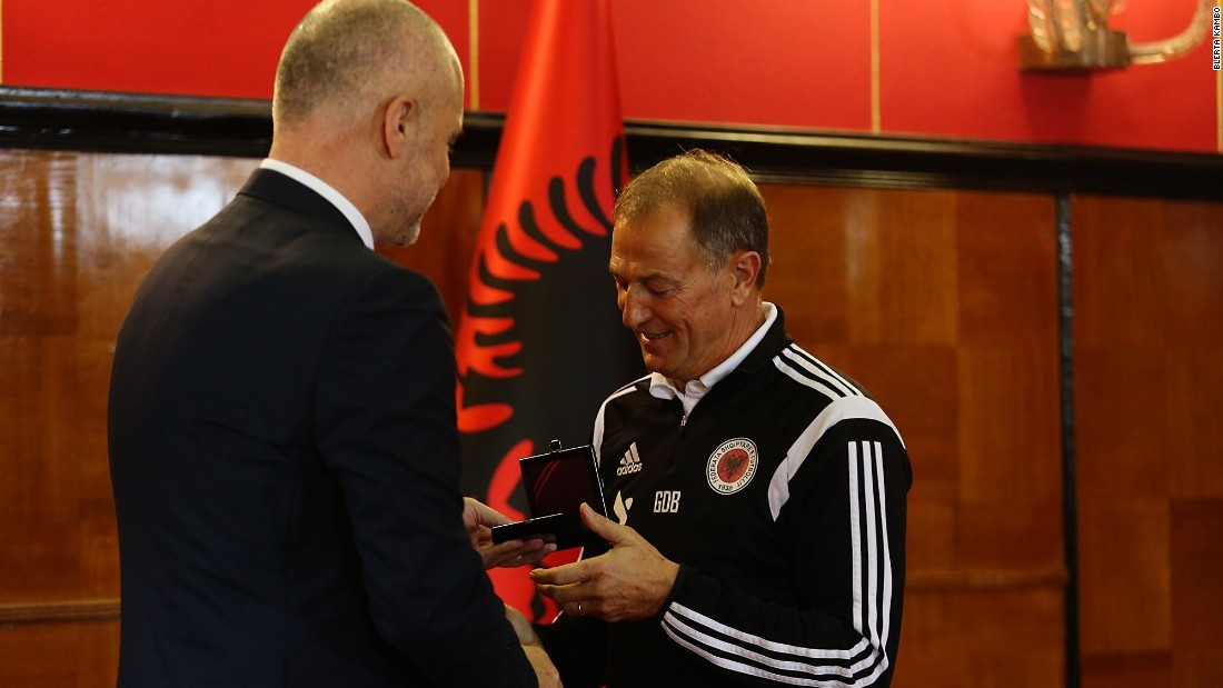 Gianni De Biasi, the team's Italian coach, was awarded the prime minister's medal after leading the team to next year's finals. Each of the players also received a medal.