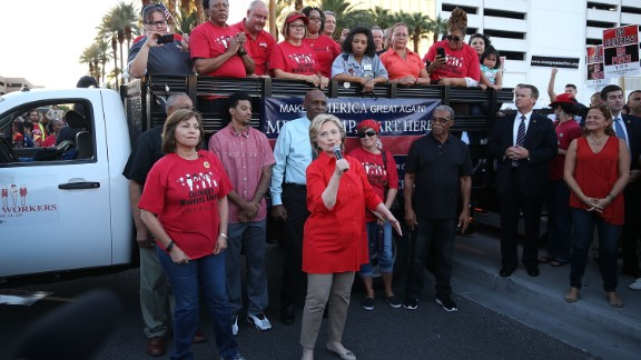 LAS VEGAS, NV - OCTOBER 12:  Democratic presidential candidate Hillary Clinton (C) speaks to union members gathered in front of the Trump International Hotel & Tower Las Vegas named and founded by the leading Republican presidential candidate Donald Trump on October 12, 2015 in Las Vegas, Nevada. Hillary Clinton is in town for a debate scheduled for tomorrow and it will be the first debate for the Democratic presidential contenders.  (Photo by Joe Raedle/Getty Images)