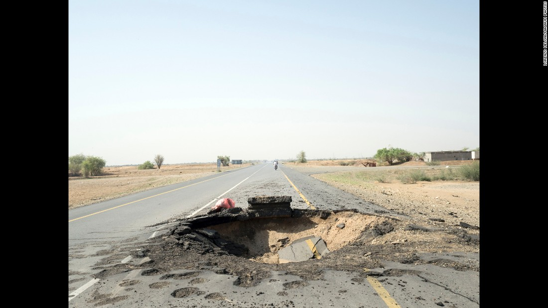 An airstrike left this crater on a road in the Hajjah Governorate.
