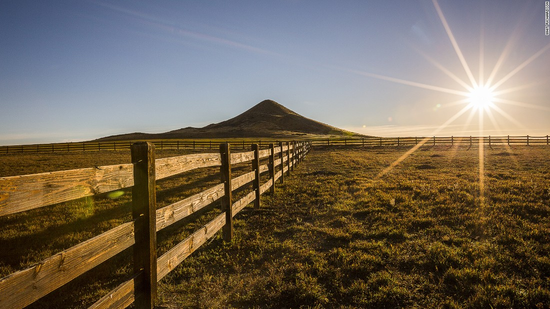 The sun sets on Ashlawn Ranch with the backdrop of Haystack Mountain.