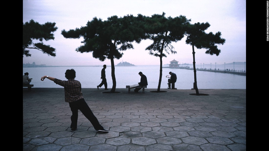 A woman in Qingdao, China, practices tai chi by the Yellow Sea in 1981. It's one of the many photographs featured in Hiroji Kubota's new retrospective photo book.