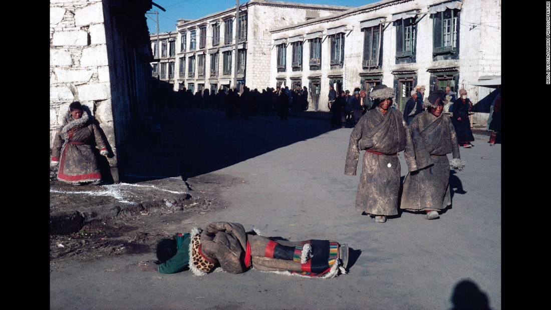 "A person prays in Lhasa, Tibet, in 1981. The pose is called ""Kechangtou,"" Kubota said, and it involves people laying on the ground and stretching out their arms and legs to pray."