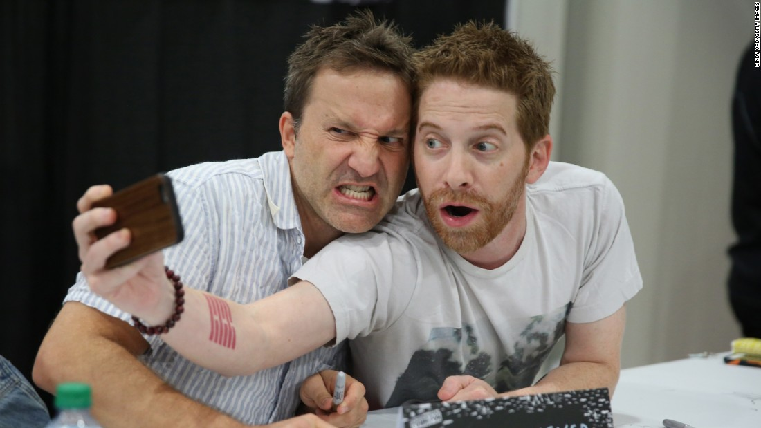 Actors Breckin Meyer, left, and Seth Green take a photo together while signing autographs at New York Comic Con on Saturday, October 10.