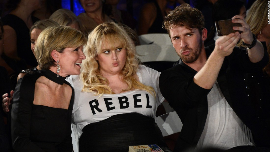 Actor Hugh Sheridan snaps a photo with actress Rebel Wilson and Australia's Minister of Foreign Affairs, Julie Bishop, while attending Los Angeles Fashion Week on Thursday, October 8. Sheridan and Wilson are both from Australia, and they were watching runway shows featuring Australian designers.