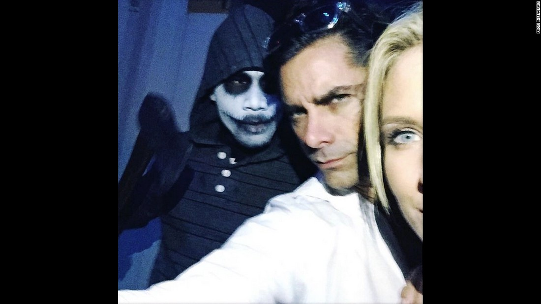 "Another Australian, actress Nicky Whelan, appears in a selfie with actor John Stamos as they visit a <a href=""http://www.halloweenhorrornights.com/hollywood/2015/?__source=hhn_2015_social"" target=""_blank"">Halloween attraction</a> at Universal Studios Hollywood on Sunday, October 11. ""Super scary night with a weird guy,"" <a href=""https://instagram.com/p/8sHV3KCh2P/"" target=""_blank"">Stamos said on Instagram.</a>"