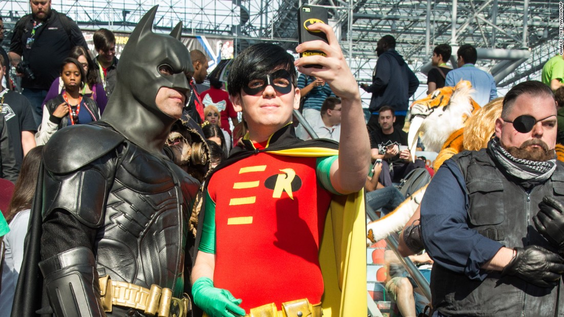 People dressed as Batman and Robin take a selfie during New York Comic Con on Friday, October 9.