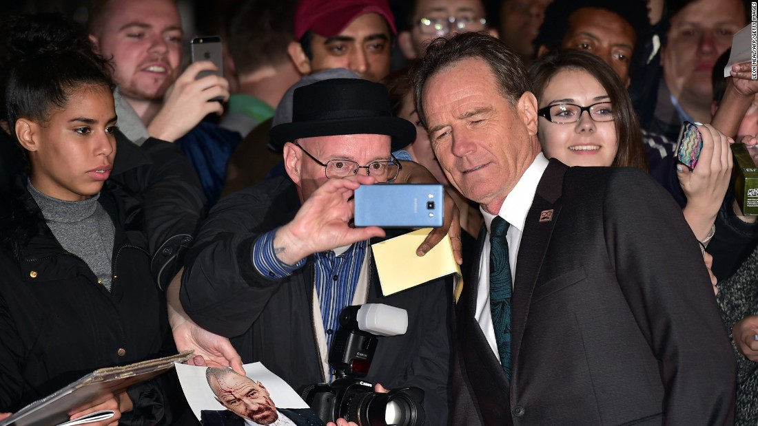 "Actor Bryan Cranston stops for a selfie with a man dressed as Walter White, Cranston's iconic character from ""Breaking Bad,"" during the London Film Festival on Thursday, October 8."