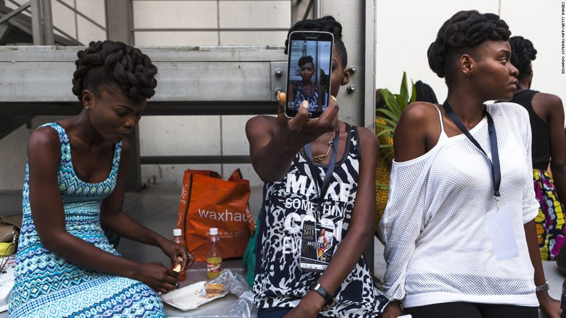 A model takes a selfie before a show at Congo Fashion Week on Thursday, October 8.