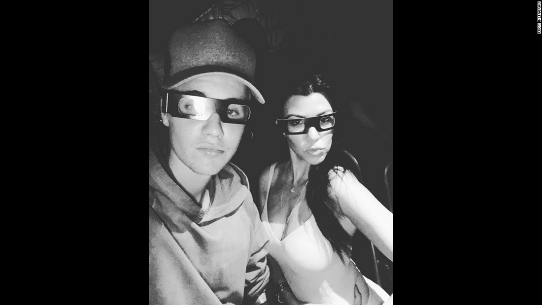 "Pop star Justin Bieber and television personality Kourtney Kardashian wear 3-D glasses as they hang out at Universal Studios Hollywood on Saturday, October 10. Bieber <a href=""https://instagram.com/p/8quMqQAvvo/"" target=""_blank"">posted the selfie</a> to his Instagram account."