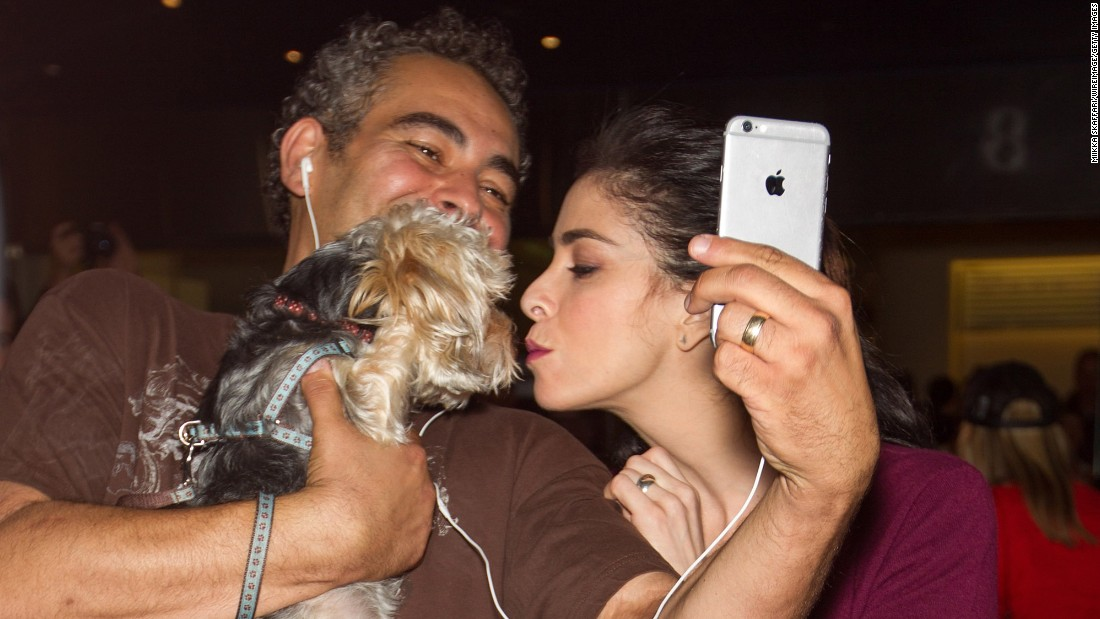 "Actress Sarah Silverman smooches a fan's dog Friday, October 9, at the ""I Smile Back"" premiere in Mill Valley, California."