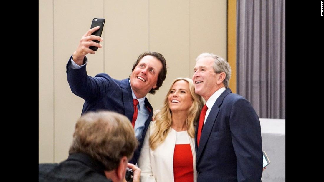 "Hall of Fame golfer Phil Mickelson takes a photo with his wife, Amy, and former U.S. President George W. Bush on Wednesday, October 7. ""Lefty is a righty when it comes to selfies,"" <a href=""https://twitter.com/PGATOUR/status/651747185936068608"" target=""_blank"">the PGA Tour tweeted.</a>"