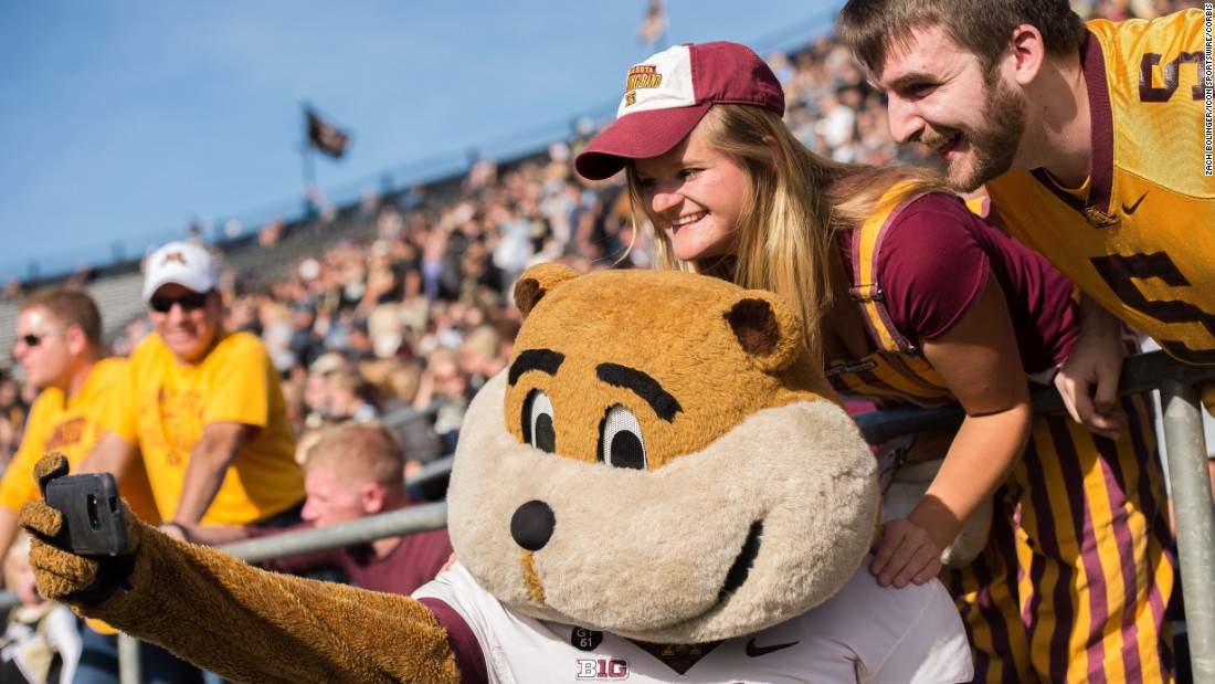 Goldy Gopher, mascot of the University of Minnesota, takes a selfie with fans at a football game in West Lafayette, Indiana, on Saturday, October 10.