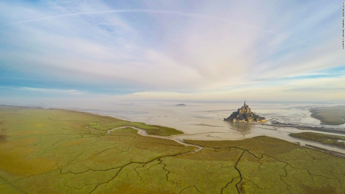 It might appear like a magical landscape from Lord of the Rings, but Mont Saint-Michel is in fact an island commune on the northwest coast of France.