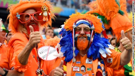 Fans dress in orange, in support of the Netherlands.
