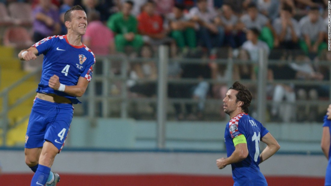 Croatia leapfrogged Norway to second place in Group H thanks to Ivan Perišić (L) hitting the only goal against Malta in the last round. It will be Croatia's third successive appearance at the finals.