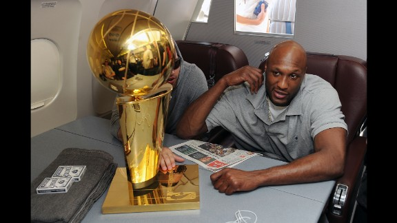 Odom sits next to the Larry O