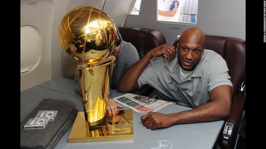 Odom sits next to the Larry O'Brien Trophy during the Lakers' flight back to Los Angeles in June 2009. The Lakers defeated the Orlando Magic for the NBA championship.