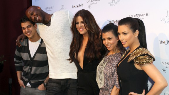 "From left, Rob Kardashian, Odom, Khloe Kardashian, Kourtney Kardashian and Kim Kardashian pose for photographers during an event in Los Angeles in April 2011. Odom was married to Khloe, and he was featured in the reality show ""Keeping Up With the Kardashians"" as well as the couple"
