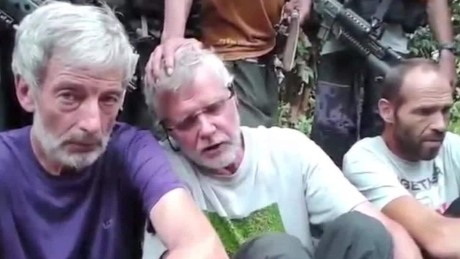 philippines hostages plead for life dnt holmes _00000000