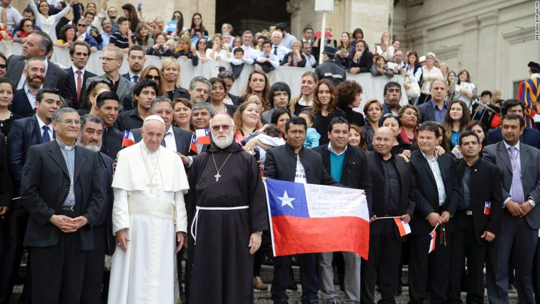 Pope Francis meets with some of the 33 Chileans who were rescued from the 2010 mining accident. The miners, who are in Rome promoting a new film about their ordeal, posed for photos and presented gifts to Francis at the Vatican on Wednesday, October 14.