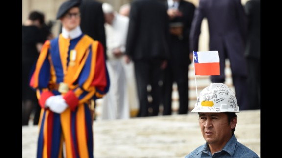 A miner waits to meet Pope Francis at the end of the weekly general audience at St. Peter's Square.