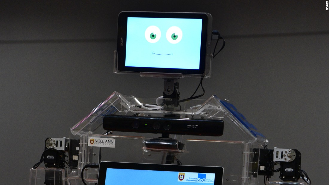 This smiley face belongs to Robocoach, an  exercise robot being rolled out in Singapore senior centers. It has two screens: One for motivation, the other for guidance.