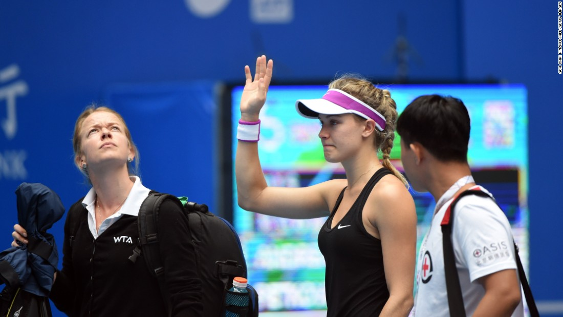An emotional Bouchard waved to the crowd in Beijing as she exited.