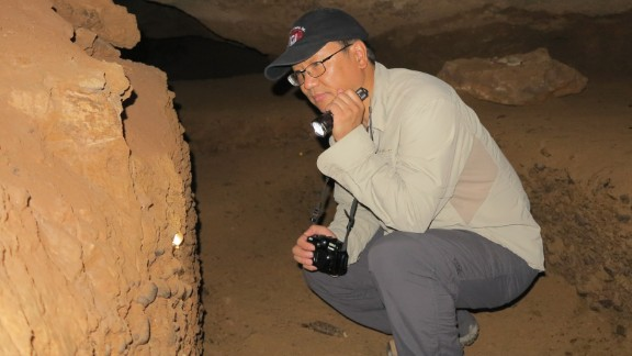 One of the lead researchers, Liu Wu, on an excavation trip to the Daoxian cave in 2014.