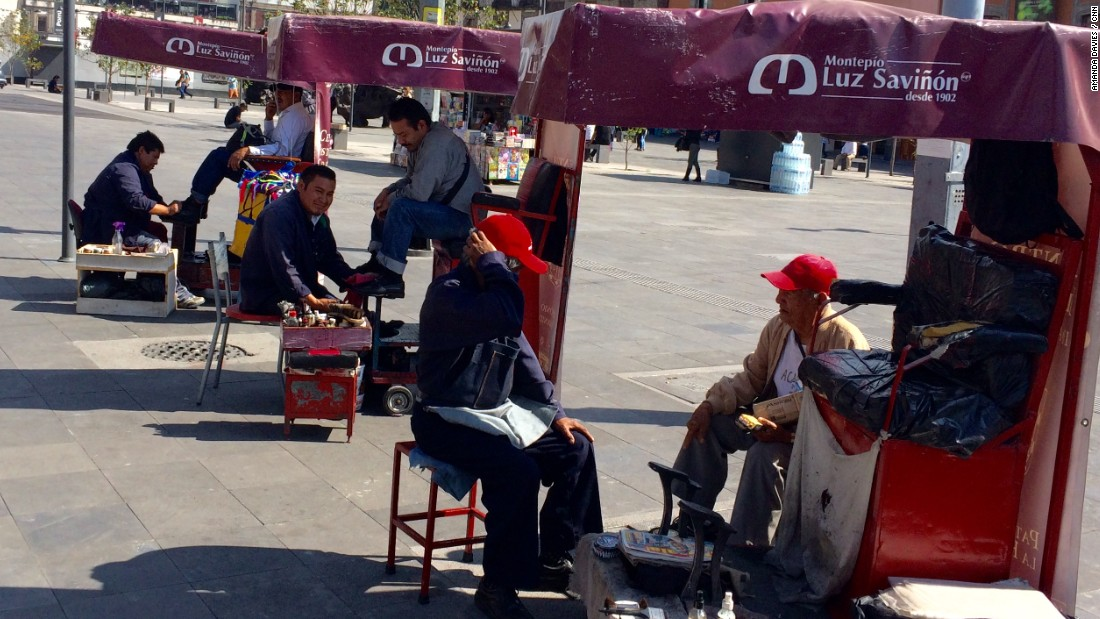 """Rows of shoe shiners in Mexico City are just one of the familiar sights in the Mexican capital,"" says Davies."