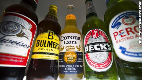 British brewer SABMiller announced Tuesday it had finally agreed a takeover by Anheuser-Busch InBev, the world's biggest beer producer -- for about $106 billion.