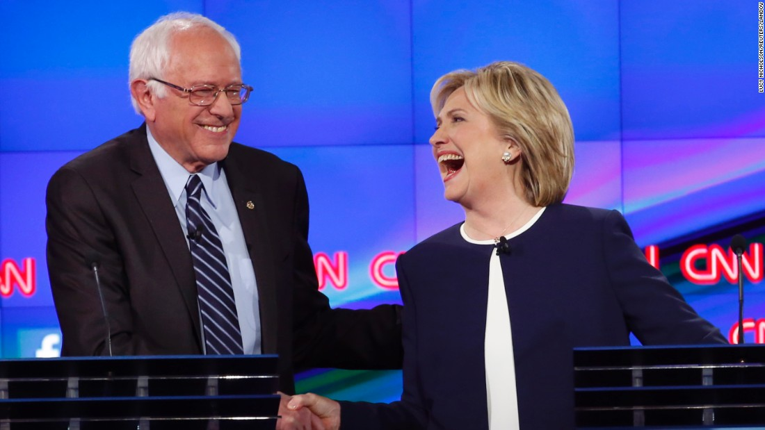 "U.S. Sen. Bernie Sanders shakes hands with fellow presidential candidate Hillary Clinton during <a href=""http://www.cnn.com/2015/10/13/politics/gallery/democratic-debate-las-vegas/index.html"" target=""_blank"">the Democratic debate</a> in Las Vegas on Tuesday, October 13. <a href=""http://www.cnn.com/videos/politics/2015/10/13/bernie-sanders-democratic-debate-sick-of-hearing-about-hillary-clinton-emails-19.cnn"" target=""_blank"">The lighthearted moment</a> came after Sanders gave his take on the Clinton email scandal. ""The American people are sick and tired of hearing about the damn emails,"" Sanders said. ""Enough of the emails. Let's talk about the real issues facing the United States of America."""