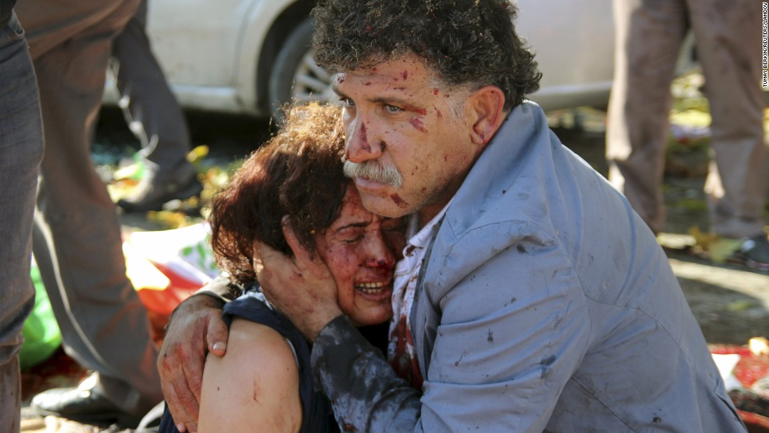 "An injured man hugs an injured woman after <a href=""http://www.cnn.com/2015/10/14/middleeast/turkey-ankara-blasts-investigation/"" target=""_blank"">a bombing at a peace rally</a> in Ankara, Turkey, on Saturday, October 10. There were two explosions during the rally, which called for an end to the renewed conflict between the Kurdistan Workers' Party and the Turkish government. At least 99 people were killed, officials said, and more than 240 were injured."