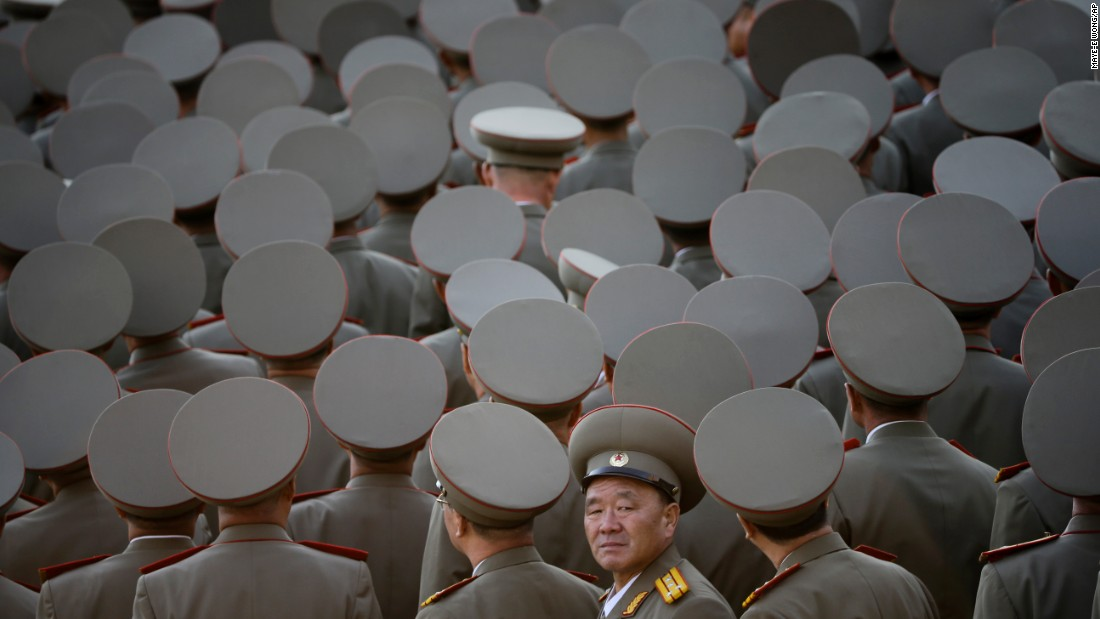 "North Korean veterans gather before the start of a <a href=""http://www.cnn.com/2015/10/10/asia/north-korea-military-parade/"" target=""_blank"">massive military parade</a> in Pyongyang, North Korea, on Saturday, October 10."